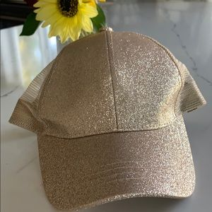 Gold hat with pony cut out